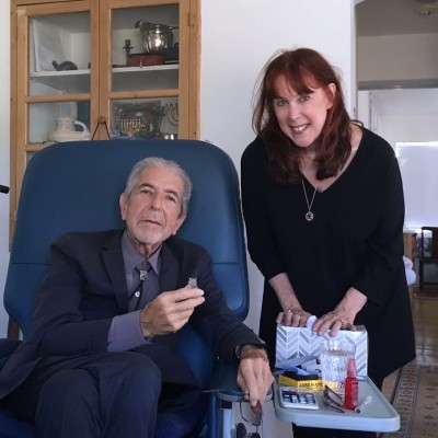 I wondered if you had seen these pictures Geoffrey of Leonard in the blue medical chair with perfumer Mandy Aftel - taken 11th August.  He looks so frail bless him ..<br />June x